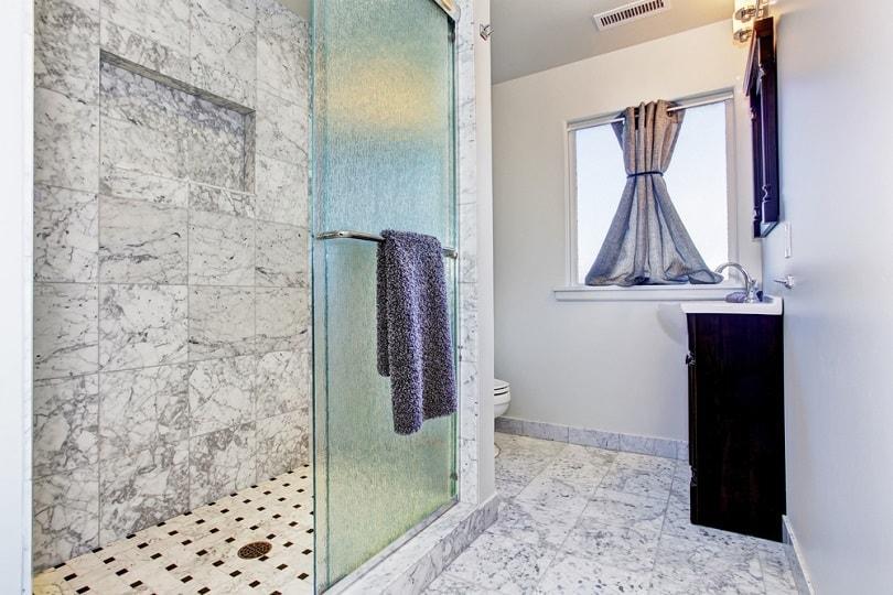 Bathroom with granite tile floor_artazum_shutterstock