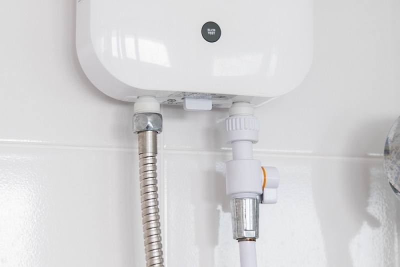 Instant tankless electric water heater installed_kensoftTH_shutterstock