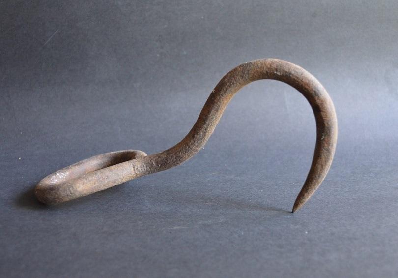 Old Rusty Cast Iron Meat Hook_TheOldBarnDoor_shutterstock