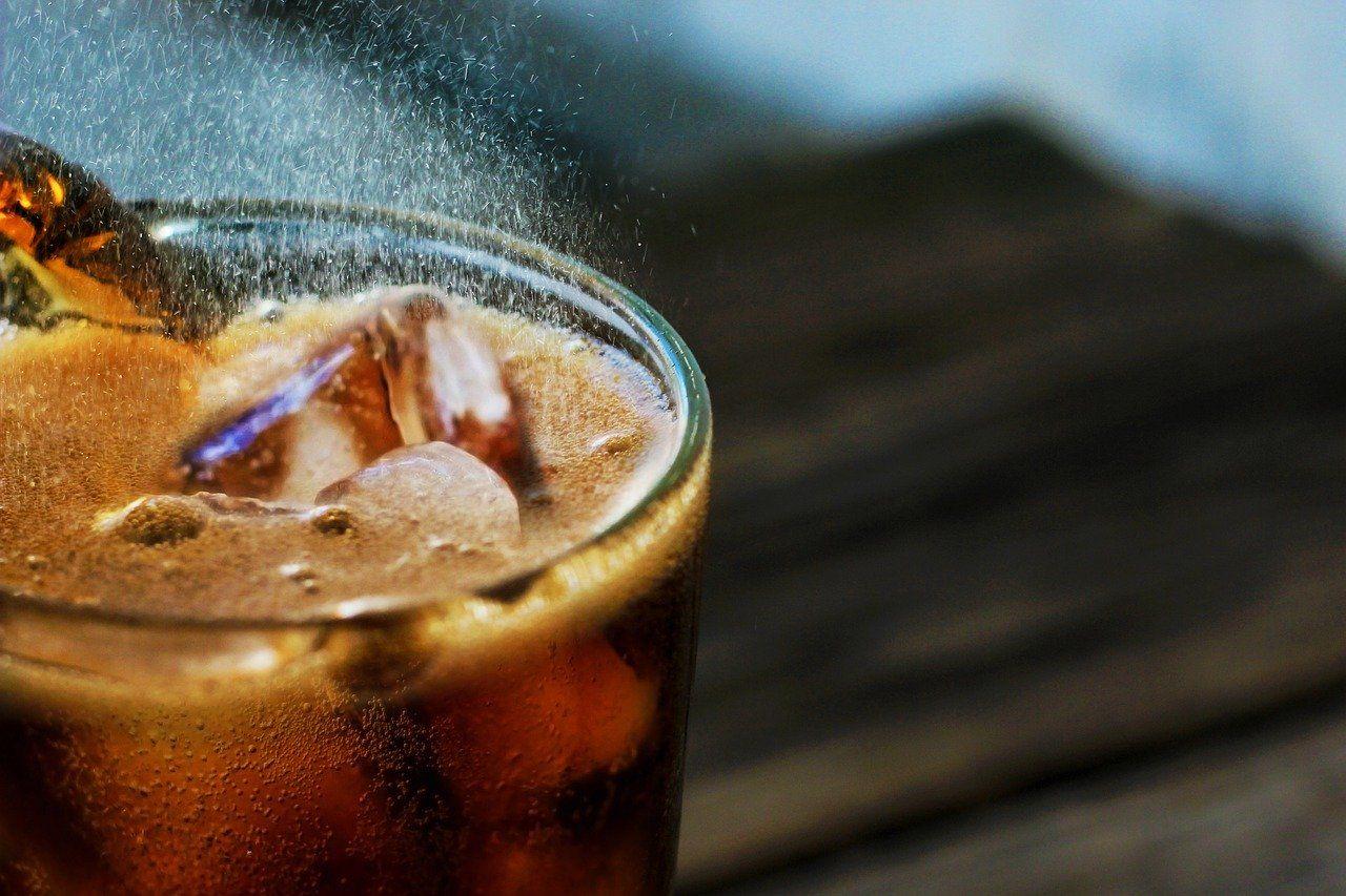 close up photo of a soda in a glass