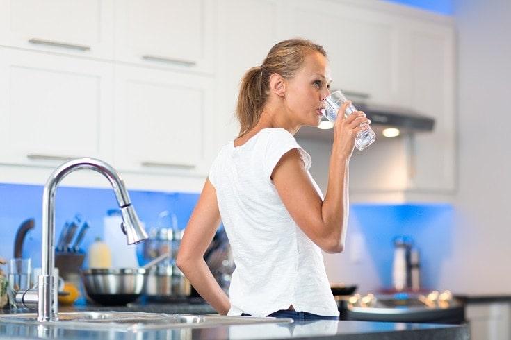 woman drinking tap_shutterstock_l i g h t p o e t